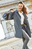 Happy young fashion-monger in trench coat in Paris, France. Stylish autumn in Paris. happy young fashion-monger in trench coat in Paris, France Royalty Free Stock Photography