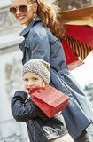 Mother and child near Arc de Triomphe in Paris, France walking. Stylish autumn in Paris. smiling young mother and child with shopping bags near Arc de Triomphe Stock Photography