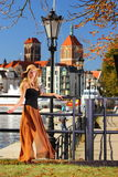 Stylish autumn woman in old town Gdansk Royalty Free Stock Photography