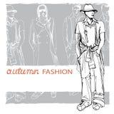 Stylish autumnal dude on grunge background. Royalty Free Stock Photo