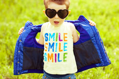 Stylish baby boy with ginger (red) hair in trendy sunglasses Stock Photos