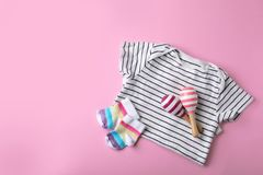Stylish baby clothes and toys on color background, top view. Space for text stock images