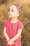 Stylish baby girl outdoors Royalty Free Stock Photos
