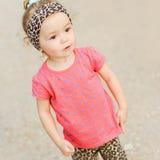 Stylish baby girl walking outdoors Stock Images