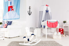 Stylish baby room. Stylish and happy baby room in marine style Royalty Free Stock Image