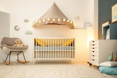 Stylish baby room interior. With crib Stock Images