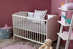 Stylish baby room interior. With crib Stock Photo