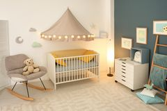 Stylish baby room interior. With crib Royalty Free Stock Images