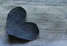 Stylish background from exhaust of a lonely heart denim on the b Royalty Free Stock Photos