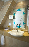 Stylish bathroom. A stylish bathroom with beautiful mirror Stock Photography