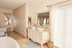 Stylish bathroom and bedroom interior in a modern suburban home Royalty Free Stock Photography