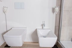 Stylish bathroom with bidet and WC in white Stock Image