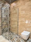 Modern shower cabin. Stylish bathroom with shower cabin and toilet bowl Stock Images
