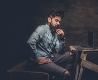 Stylish  Indian male working with laptop. Stylish bearded Indian male working with laptop Royalty Free Stock Images