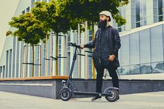 A man posing on electric scooter. stock images
