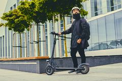 A man posing on electric scooter. royalty free stock image