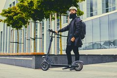 A man posing on electric scooter. royalty free stock photo