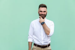 Stylish bearded man with appealing dark eyes smiling into camera. Businessman with beard grinning having cheerful look. Royalty Free Stock Photography