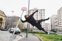 Stylish bearded man jumping in the street Royalty Free Stock Photo