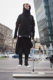 Stylish bearded man levitating in the street Royalty Free Stock Photography