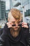 Stylish bearded man posing in the street Stock Photo