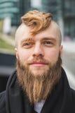 Stylish bearded man posing in the street Royalty Free Stock Photo