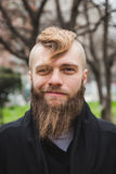 Stylish bearded man posing in the street Royalty Free Stock Images