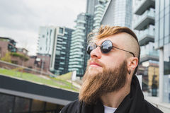 Stylish bearded man posing in the street Royalty Free Stock Photography