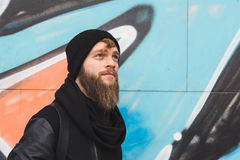 Stylish bearded man posing in the street Stock Photography