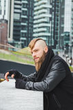 Stylish bearded man posing in the street Royalty Free Stock Photos