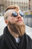 Stylish bearded man posing in the street Stock Photo