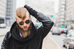Stylish bearded man posing in the street Royalty Free Stock Image