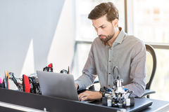 Stylish bearded man sitting in office Royalty Free Stock Image
