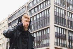Stylish bearded man talking on phone Royalty Free Stock Images