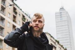 Stylish bearded man talking on phone Stock Images