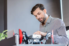 Stylish bearded man is working with concentration royalty free stock photos