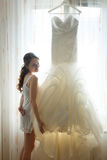 Stylish beautiful bride is posing in lingerie at her  wedding dr Stock Image