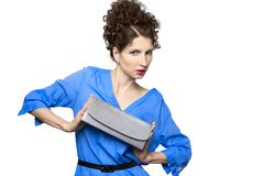 Stylish beautiful brunette with clutch Royalty Free Stock Images