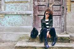 Stylish beautiful brunette woman wearing sunglasses with jacket Stock Image