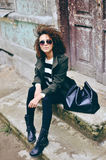 Stylish beautiful brunette woman wearing sunglasses with jacket Royalty Free Stock Image