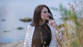 Stylish beautiful girl posing on camera stock footage