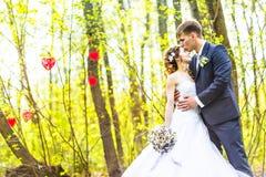 Stylish beautiful happy bride and groom, wedding celebrations outdoor Stock Photo