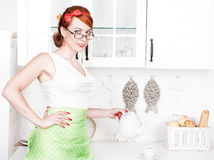 Stylish beautiful housewife with teapot Royalty Free Stock Images