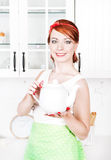 Stylish beautiful housewife with teapot Stock Photo
