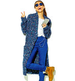 Stylish beautiful model in summer stylish clothes in studio Royalty Free Stock Photography
