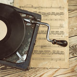 Stylish beautiful old gramophone with manual winding on a wooden table. Stock Photo