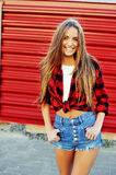 Stylish beautiful smiling girl in modern casual clothes Royalty Free Stock Image
