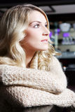 Stylish beautiful woman. Profile portrait of a stylish beautiful blond woman lost in thought staring off to the right of the frame Royalty Free Stock Photography