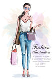 Stylish beautiful woman with shopping bags. Sketch. Hand drawn girl in fashion clothes. Stock Photo