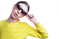 Stylish beautiful woman in sunglasses and bright sweater Stock Image
